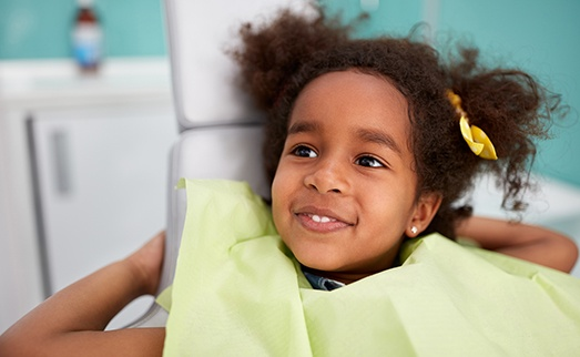 Smiling child in dental chair