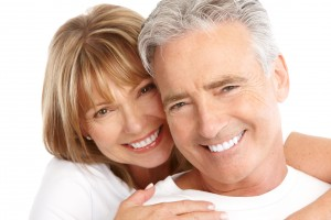smiling couple with dental work